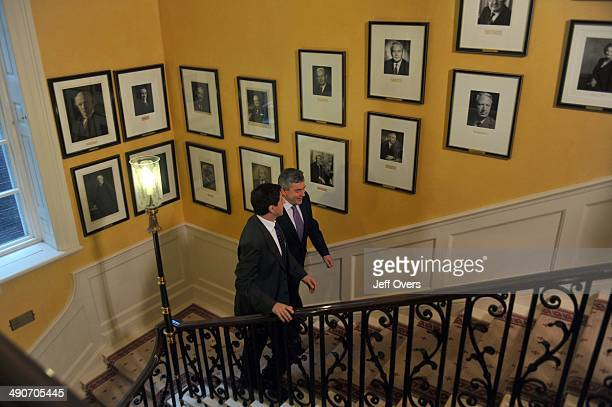 Prime Minister Gordon Brown walks up the stairs in Downing Street to be interviewed by Jon Sopel on the BBC Politics Show on November 23 2008 in...