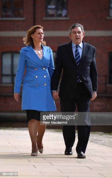 Prime Minister Gordon Brown walks with his wife Sarah on April 14 2010 in central Leeds England The General Election to be held on May 6 2010 is set...