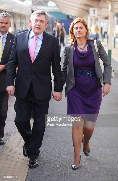 Prime Minister Gordon Brown walks with his wife Sarah onto the platform at Chester railway station after a day of campaigning on April 12 2010 in...