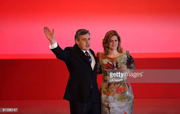 Prime Minister Gordon Brown waves with his wife Sarah after addressing the Labour Party Conference on September 29 2009 in Brighton England In what...