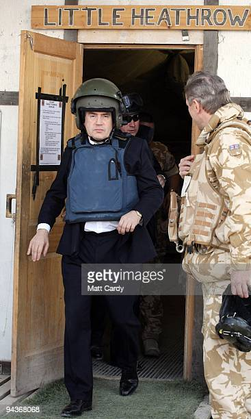 Prime Minister Gordon Brown wears a helmet and body armour as he leaves 'Little Heathrow' at Kandahar Airbase on December 13 2009 in Kandahar...