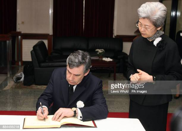 Prime Minister Gordon Brown with Chinese ambassador Fu Ying signing the book of condolences at the Chinese Embassy in London to pay respects to those...