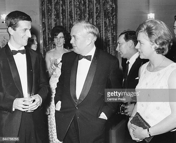 Prime Minister Harold Wilson talking to horse rider Marion Coakes and cyclist Tommy Simpson at the annual dinner of the Sports Writers Association...