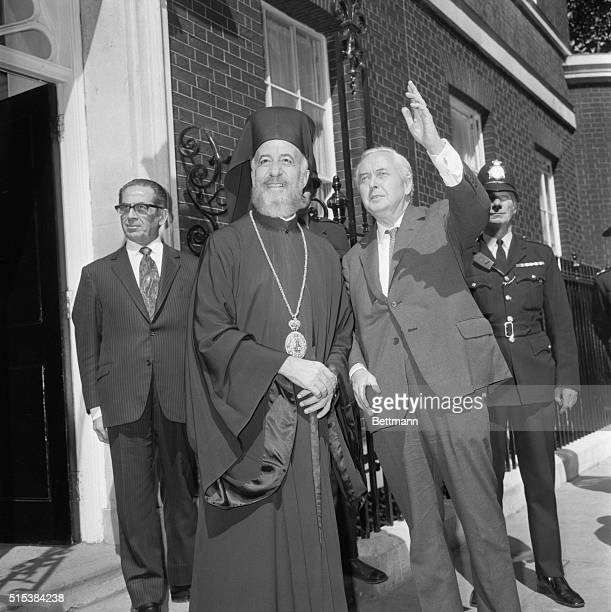 Prime Minister Harold Wilson waves to crowd as he bids farewell to Archbishop Makarios of Cyprus following meeting at 10 Downing Street 7/17