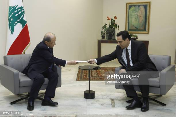 Prime Minister Hassan Diab submits the resignation letter of the government to Lebanese President Michel Aoun at the Baabda Palace in Beirut, Lebanon...
