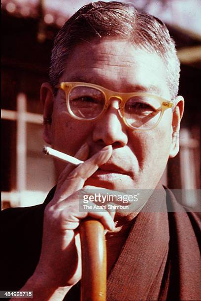 Prime Minister Hayato Ikeda poses for photographs at his home in December 1960 in Tokyo Japan Hayato Ikeda was three time Prime Minister of Japan...