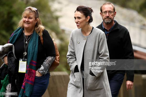 Prime Minister Jacinda Ardern and Andrew Little the Minister Responsible for Pike River Reentry approach the Pike River Mine Portal with family...
