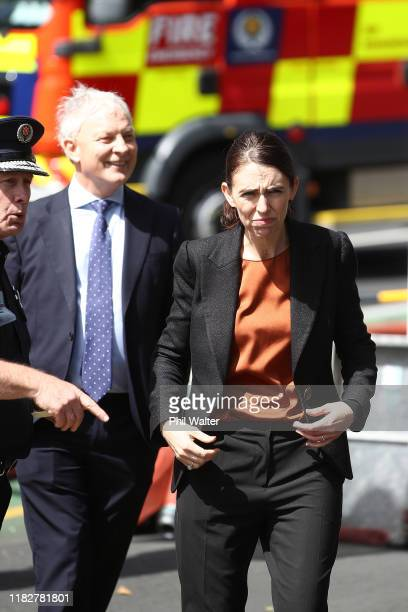 Prime Minister Jacinda Ardern and Auckland Mayor Phil Goff meet with firefighters and saftey officials outside the SkyCity Convention Centre on...