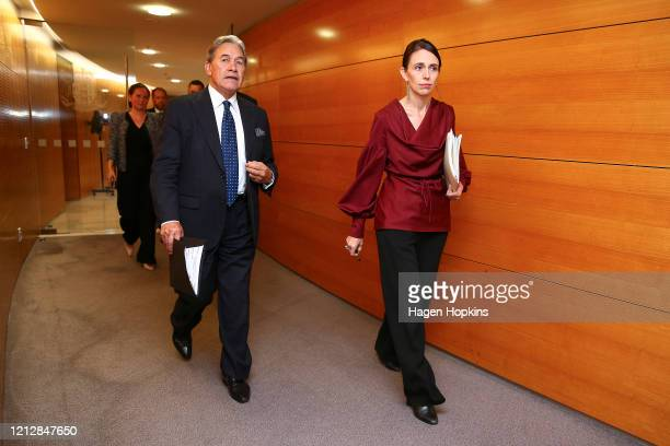 Prime Minister Jacinda Ardern and Deputy Prime Minister Winston Peters arrive at a press conference following a COVID-19 financial response package...
