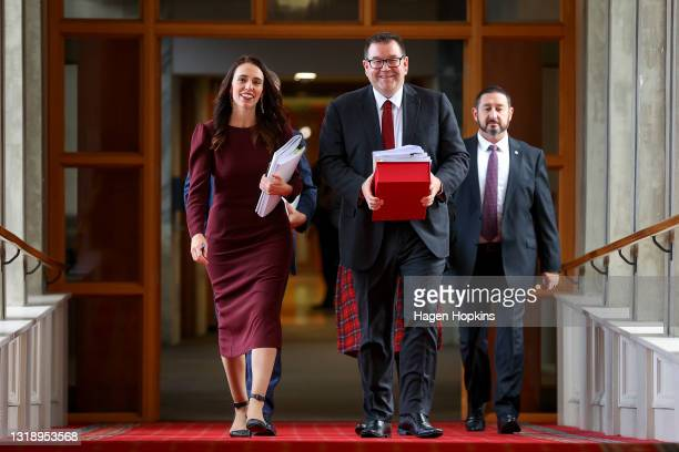 Prime Minister Jacinda Ardern and Finance Minister Grant Robertson make their way to the house during budget day 2021 at Parliament on May 20, 2021...