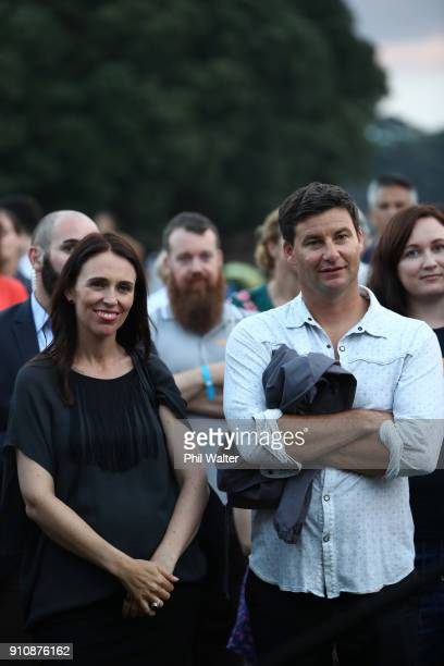Prime Minister Jacinda Ardern and her partner Clarke Gayford look on at Little Shoal Bay during the official launch party on January 27 2018 in...