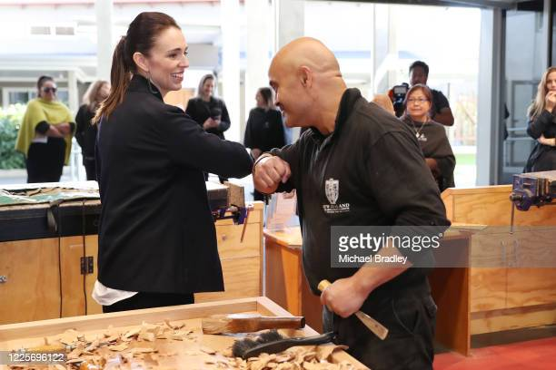 Prime Minister Jacinda Ardern bumps elbows with Albert Te Pou Master Carver during a tour of Te Puia New Zealand Māori Arts and Crafts Institute on...