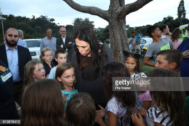 Prime Minister Jacinda Ardern chats with children during the official light turn on launch party at Little Shoal Bay on January 27 2018 in Auckland...