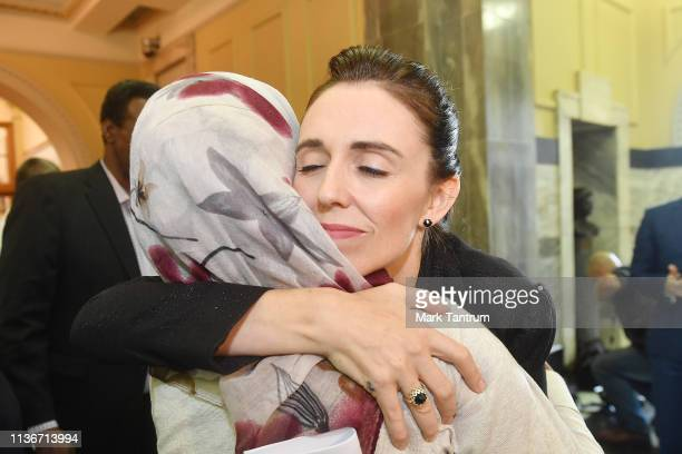 Prime Minister Jacinda Ardern embraces a woman who attended the House session at Parliament on March 19 2019 in Wellington New Zealand 50 people were...
