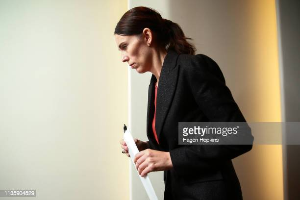 Prime Minister Jacinda Ardern exits after a press conference at Parliament on March 15 2019 in Wellington New Zealand One person is in custody and...