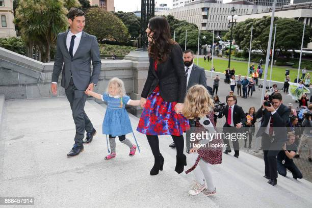 Prime Minister Jacinda Ardern her nieces and partner Clarke Gayford arrive at Parliament after a swearingin ceremony at Government House on October...