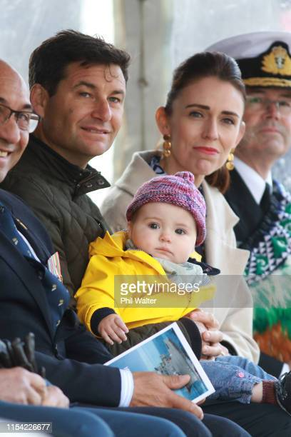 Prime Minister Jacinda Ardern her partner Clarke Gayford and their child Neve look on after the Prime Minister formally commissioned the diving...