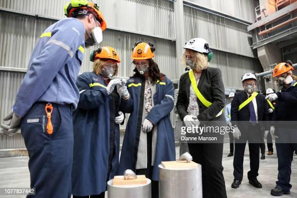 Prime Minister Jacinda Ardern holds freshly cast aluminium during her visit to the Tiwai Point Aluminium Smelter on December 06 2018 in Invercargill...