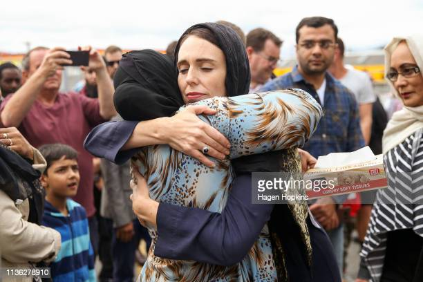 Prime Minister Jacinda Ardern hugs a mosque-goer at the Kilbirnie Mosque on March 17, 2019 in Wellington, New Zealand. 50 people are confirmed dead...