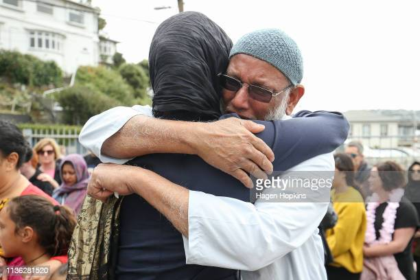 Prime Minister Jacinda Ardern hugs a mosquegoer at the Kilbirnie Mosque on March 17 2019 in Wellington New Zealand 50 people are confirmed dead and...