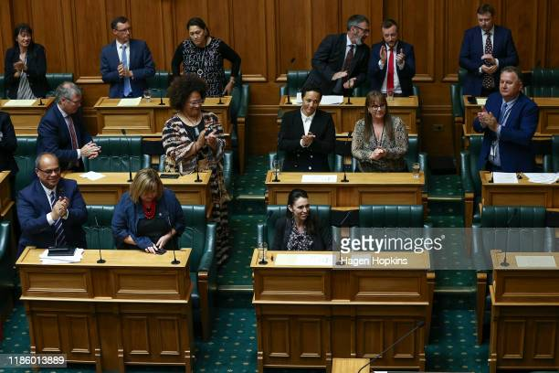 Prime Minister Jacinda Ardern is applauded by colleagues after speaking in the house during the third reading of the The Zero Carbon bill at...