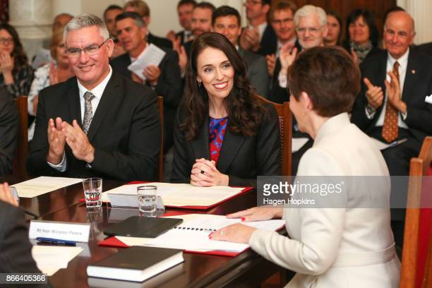 Prime Minister Jacinda Ardern is sworn in by GovernorGeneral Dame Patsy Reddy while deputy Labour leader Kelvin Davis looks on during a swearingin...