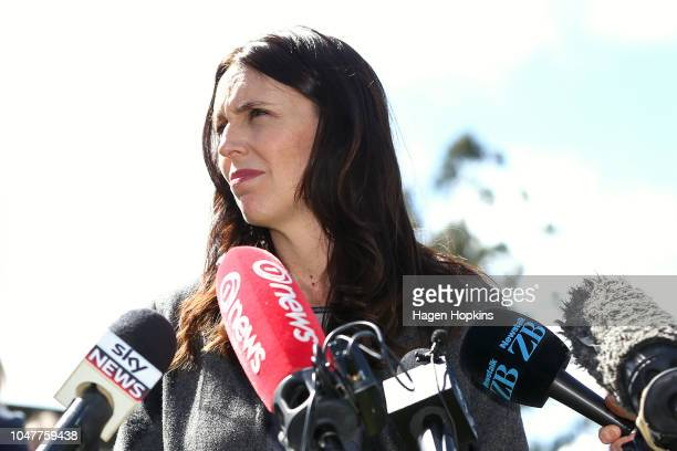 Prime Minister Jacinda Ardern looks on while addressing media during a visit to Julie and Bryce StevensonÕs beef farm on October 9 2018 in Masterton...