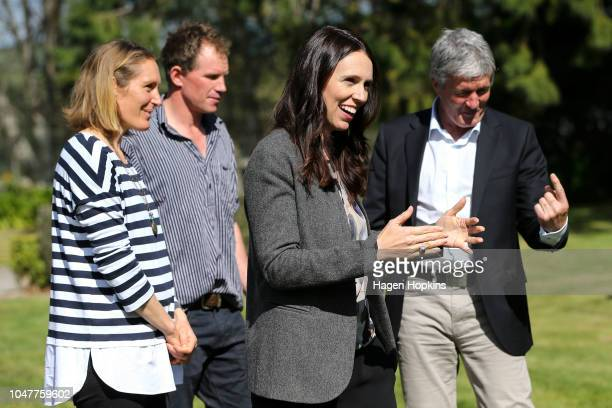 Prime Minister Jacinda Ardern looks on while Biosecurity Minister Damien OÕConnor speaks to Julie and Bryce Stevenson during a visit to the...