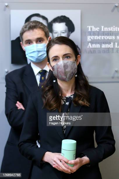 Prime Minister Jacinda Ardern looks on while wearing a face mask during a visit to the Malaghan Institute of Medical Research at Victoria University...