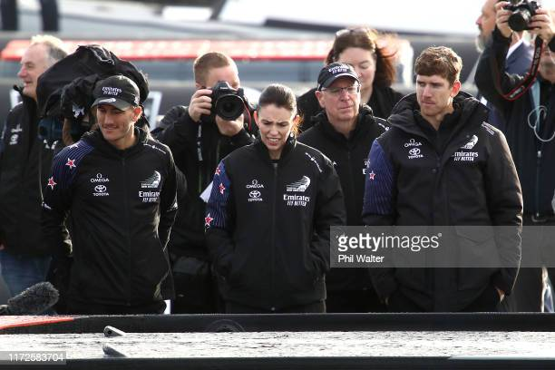 Prime Minister Jacinda Ardern looks over the Team New Zealand Americas Cup yacht, named Te Aihe with sailors Peter Burling and Blair Tuke outside the...