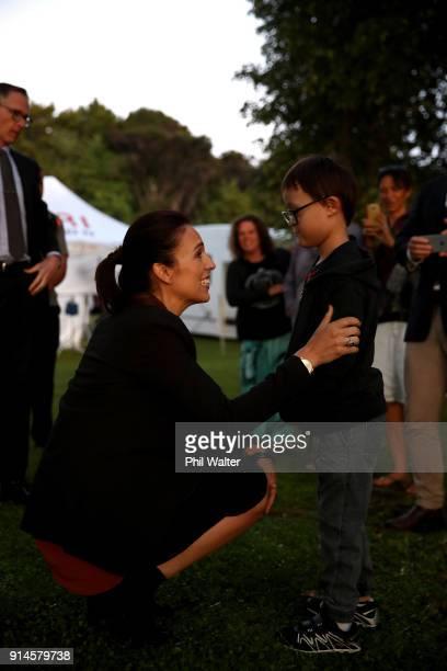 Prime Minister Jacinda Ardern meets a young boy followig the Waitangi Day Dawn Service on February 6 2018 in Waitangi New Zealand The Waitangi Day...