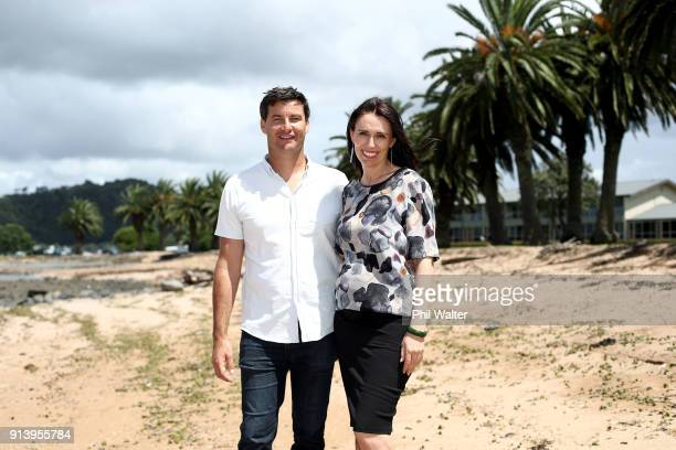 Prime Minister Jacinda Ardern poses with her partner Clarke Gayford on February 4 2018 in Waitangi New Zealand Ardern and Gayford are expecting their...