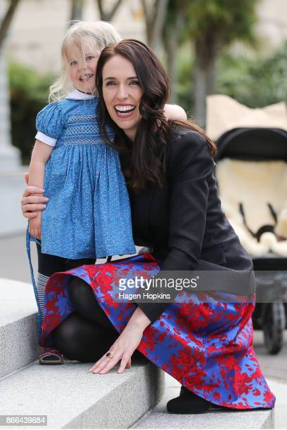 Prime Minister Jacinda Ardern says hello to the niece of partner Clarke Gayford Rosie Cowan during her arrival at Parliament after a swearingin...