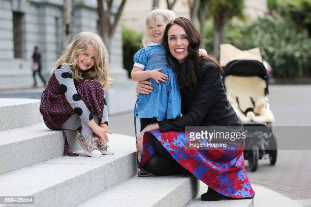 Prime Minister Jacinda Ardern says hello to the nieces of partner Clarke Gayford Nina Cowan and Rosie Cowan during her arrival at Parliament after a...