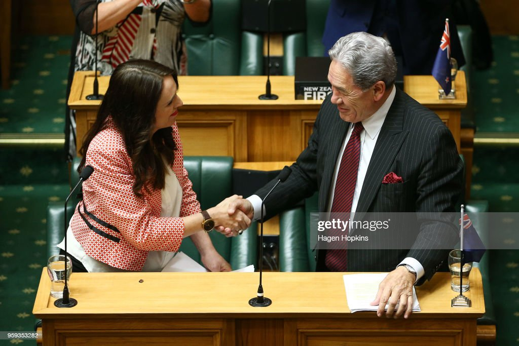 Prime Minister Jacinda Ardern shakes hands with Deputy Prime Minister Winston Peters after her speech during the 2018 budget presentation at Parliament on May 17, 2018 in Wellington, New Zealand. Grant Robertson delivered his first budget which sees a large investment in the health sector including cheaper doctor visits and investment in hospitals along with $1.6b dollars of new funding for the education sector over the next four years.