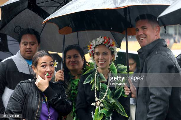 Prime Minister Jacinda Ardern shelters from the rain as she meets with public during a walk around the Pasifika Festival at Mt Smart Stadium on April...