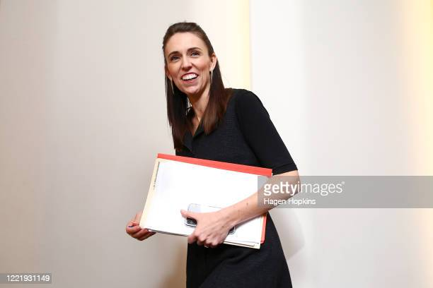 Prime Minister Jacinda Ardern speaks to a journalist as she exits a press conference at Parliament on April 30 2020 in Wellington New Zealand New...