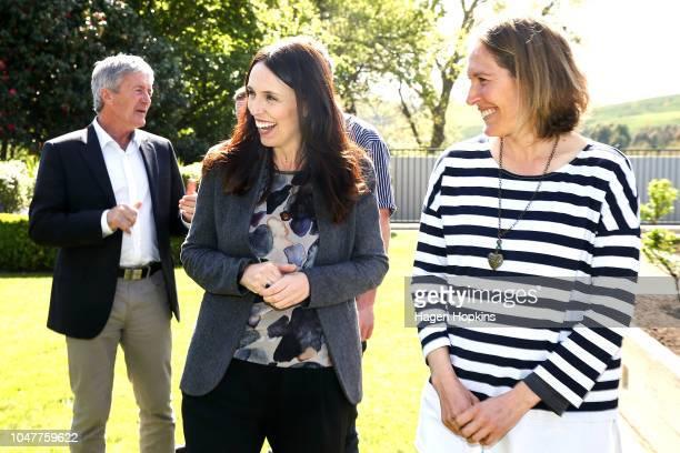 Prime Minister Jacinda Ardern speaks to Julie Stevenson during a visit to the Stevenson's beef farm on October 9 2018 in Masterton New Zealand The...