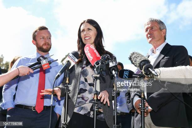 Prime Minister Jacinda Ardern speaks while Biosecurity Minister Damien OÕConnor and MP Kieran McAnulty look on during a visit to Julie and Bryce...
