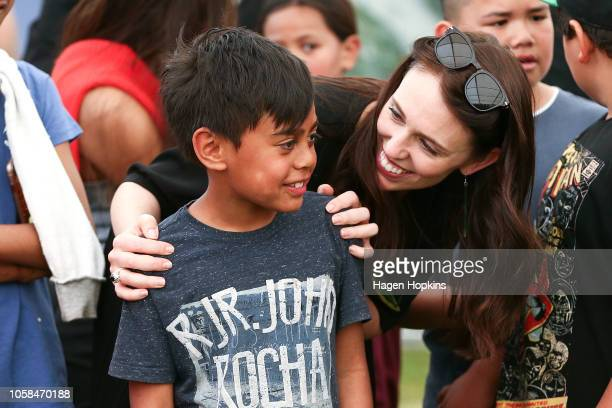 Prime Minister Jacinda Ardern talks to children during centenary celebrations at Ratana Church on November 7 2018 in Ratana New Zealand This year...