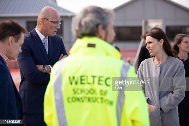 Prime Minister Jacinda Ardern talks to Warwick Quinn during a visit to Weltec School of Construction on May 15 2020 in Wellington New Zealand Ardern...