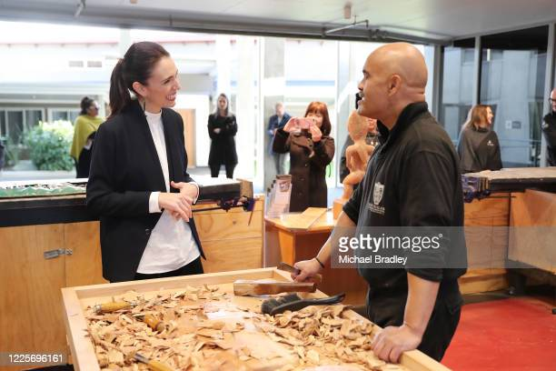 Prime Minister Jacinda Ardern talks with Albert Te Pou Master Carver during a tour of Te Puia New Zealand Māori Arts and Crafts Institute on May 19...