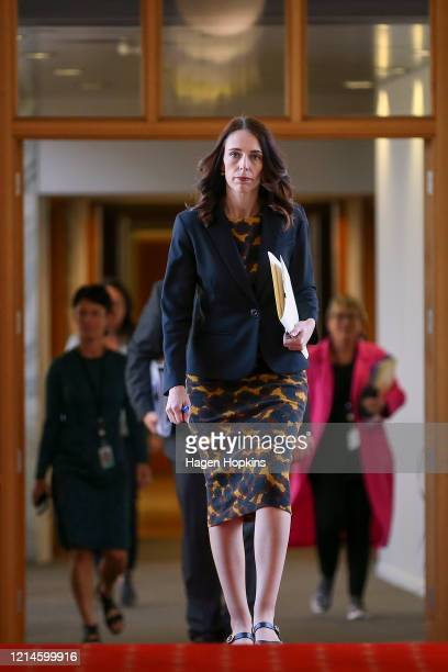 Prime Minister Jacinda Ardern walks to the house to declare a State of National Emergency to fight COVID-19 ahead of a nationwide lockdown on March...