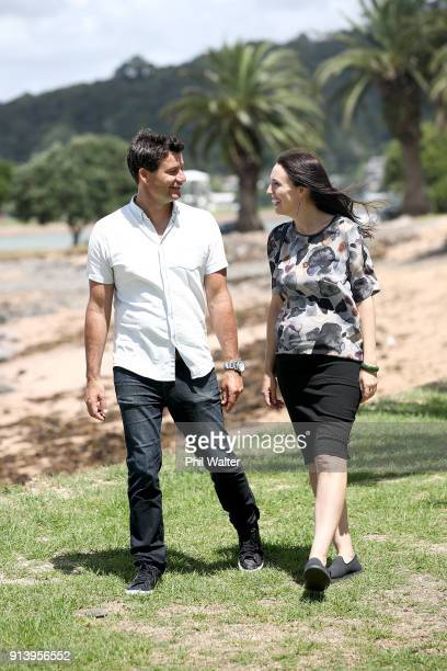 Prime Minister Jacinda Ardern walks with her partner Clarke Gayford on February 4, 2018 in Waitangi, New Zealand. Ardern and Gayford are expecting...