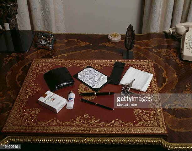 Prime Minister Jacques Chirac has emptied his pockets for Paris Match on his desk arranged on a blotter a Montblanc pen the same for many years Ball...