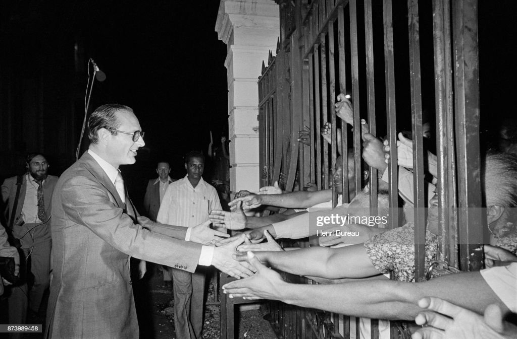 Prime Minister Jacques Chirac in Fort-de-France at the hotel 'Méridien'. On the other side of the bay, Jacques Chirac greets the small crowd waiting for him at the exit, 23d December 1975