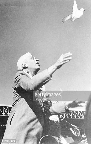 Prime Minister Jawaharlal Nehru, who recently celebrated his 66th birthday, releases a white pigeon, symbolic of peace, at festivities in New Delhi....