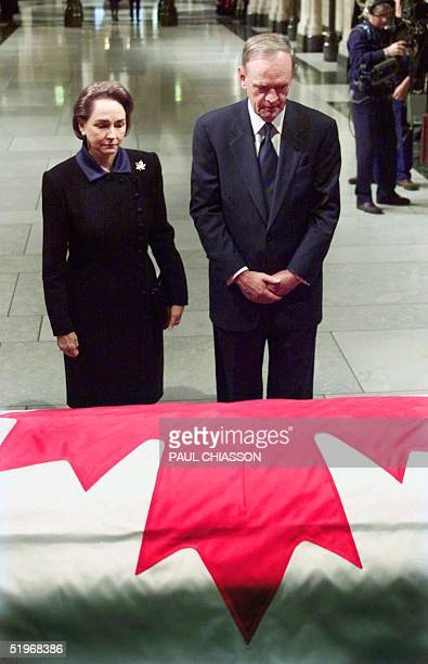 Prime Minister Jean Chretien and his wife Aline stand in front of the casket of former prime minister Pierre Trudeau in the Hall of Honour in...