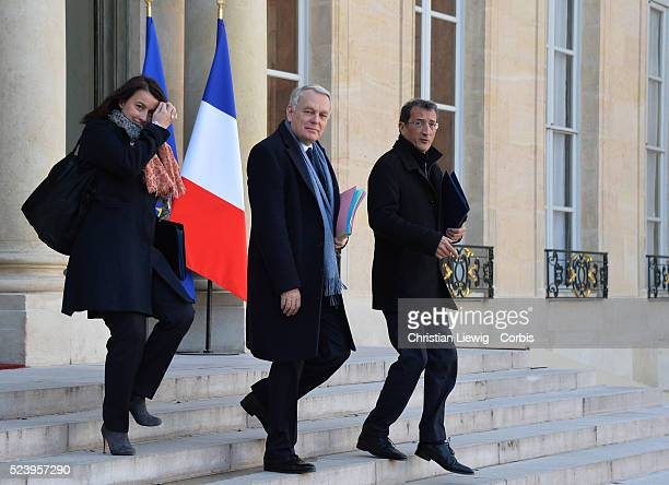 Prime Minister Jean-Marc Ayrault, Minister of Territorial Equality and Housing Cecile Duflot and Junior Minister for Cities Francois Lamy leave the...