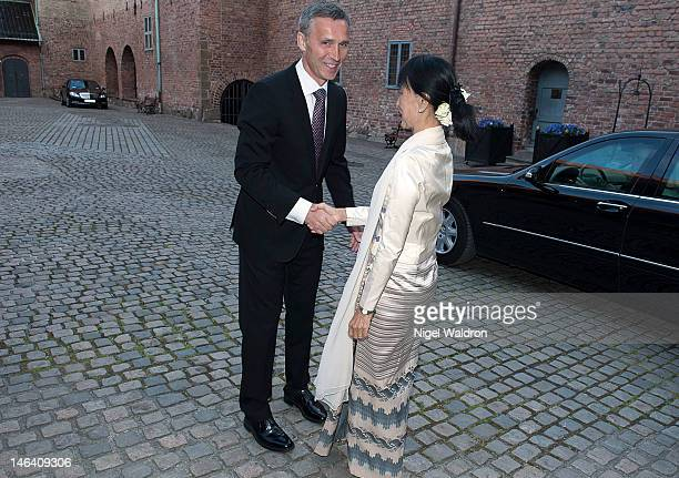 Prime Minister Jens Stoltenberg of Norway welcomes Nobel Peace Prize Laureate Aung San Suu Kyi of Burma at a dinner reception Akerhus Castle on June...
